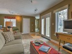 Boasting 2 large decks, a flat-screen Smart TV, and wood-burning stove, this 1,800-square-foot-home is the epitome of...