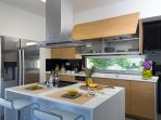 Fully equipped kitchen with branded electric devices & direct access to barbecue