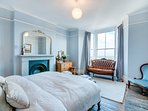 Master bedroom with walk in wardrobe & antique sofa to enjoy sea views & sunset