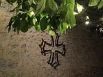 Cathar cross made by Guy and pretty fairy lights in the trees.