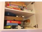 A cupboard with table games like chess, rumikov and more.