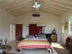 King suite with AC, ceiling fan, dresser, and huge walking closet.