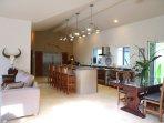 Welcome to La Hacienda Ojo de Agua open concept living and dining.