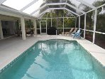 Beautiful heated pool with a full caged in backyard.