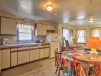 This townhome-style unit includes a well-equipped kitchen, spacious bedrooms and a flat-screen TV.