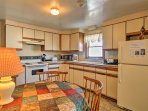 The kitchen provides all the essential appliances and a round dining table for family feasts.
