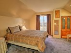 This bedroom provides a queen bed for 2 guests.