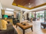 Living dining area with pool view.