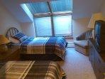 New living room with hardwood floors, sleeper sofa, fireplace, HDTV