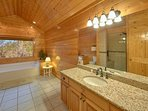 Relax in the spacious master bathroom with walk in shower and whirlpool tub.