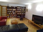 living/dining room with books in russian, english, dutch and romanian