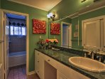 The en-suite bathroom offers ample counter space to host your travel toiletries.