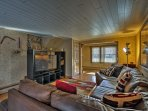 Kick back on the leather sectional couch in front of the flat-screen cable TV in this first den.