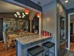 There's a chic breakfast bar with pendant lighting perfect for 2.