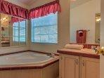 Draw yourself a bubble bath in the master en-suite bathroom.