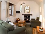 Cosy sitting room, wood burner, TV/DVD, DVD library, WiFi, central heating and USB power sockets.