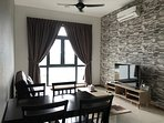 living area with 4 seater dining table