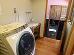 Shared washing machine & iron with iron board included.