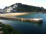 Looe 's beach and famous Banjo Pier provide the location for the yearly Music Festival in September.
