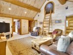 Expansive loft area with ladder access to the upper kids bedroom
