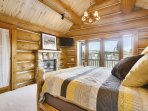 Master bedroom suite with gas fireplace and TV