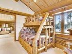 Custom log beds in bunk room