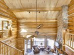 Two story great room with beautiful log detailing