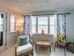 Living Area boasts beautiful water views and opens to the Condo Balcony