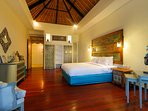 Bedroom with a combination of modern amenities and traditional Balinese decor