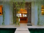 Grand entrance into the villa with welcoming hanging plants
