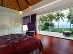 Large luxurious bedroom with stunning views of the sea
