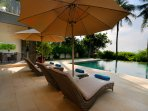 Comfortable sun loungers with views of the pool and the sea