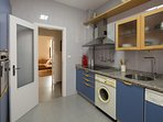 The kitchen includes an oven, dishwasher and washing-machine.