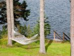 Relax on the hammock while listening to the music of the waves