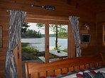 Master bedroom overlooks lake