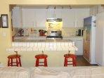 Kitchen, new dishwasher and gas range.