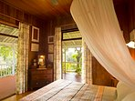 Main Bedroom which opens out on to the verandah and has river views.