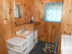 Bathroom in Mallard cottage; shower and washer on the right.