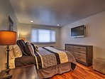 The master bedroom includes the added luxuries of a flat-screen cable Smart TV and en-suite bath.