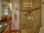 Wash up in the walk-in shower and single vanity found in the master en-suite bathroom.