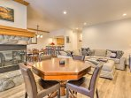 The updated interior features an open-concept layout combining the living area, game area, kitchen and dining room.