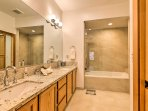 The en-suite master bathroom provides a double vanity and an upgraded shower/tub combo.