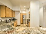 The kitchen is fully equipped with new appliances, countertops and cabinetry to help prepare your favorite recipes.