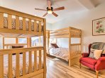 Kids can make their home base in this spacious room with 2 twin-over-twin bunk beds.