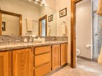 This bathroom offers plenty of space for guests to share between the bedrooms.