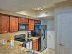 The fully equipped kitchen boasts granite counters and updated appliances.