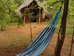 Chill in the hammock next to your clay yurt