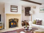 The stylish, cosy living room, with log burner