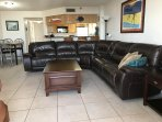 Large living room with large leather sectional sofa