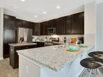 Granite counters. Stainless steel appliances.